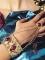 Bracelet avec bague doré et pierres rouges femme-1
